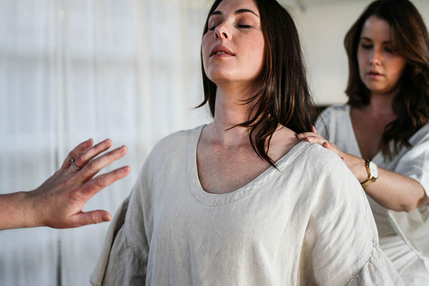 Two women practicing techniques in class